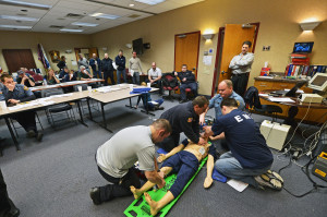 "Members training for ""Pit Crew CPR"" certification"